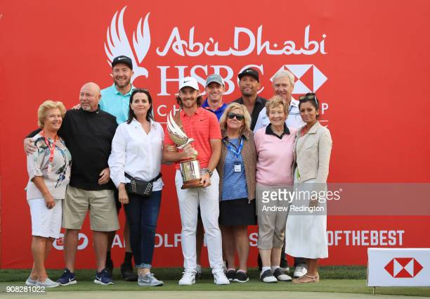 Tommy Fleetwood of England celebrates with his wife Clare Craig parents Pete and Sue caddie Ian Finnis and and others after winning during the final...