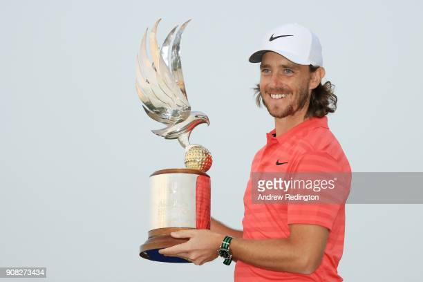Tommy Fleetwood of England celebrates with the winner's trophy after the final round of the Abu Dhabi HSBC Golf Championship at Abu Dhabi Golf Club...