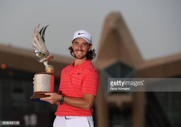 Tommy Fleetwood of England celebrates with the winners trophy after the final round of the Abu Dhabi HSBC Golf Championship at Abu Dhabi Golf Club on...