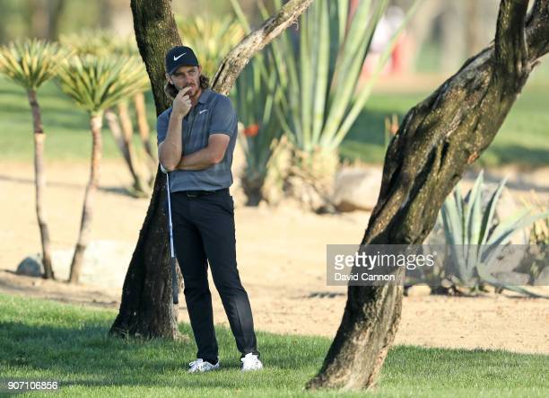 Tommy Fleetwood of England contemplates his second shot on the par 4 16th hole during the second round of the 2018 Abu Dhabi HSBC Golf Championship...