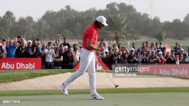 Tommy Fleetwood of England gestures as he walks on the green as he celebrates his victory at the Abu Dhabi HSBC Golf Championship at the Abu Dhabi...