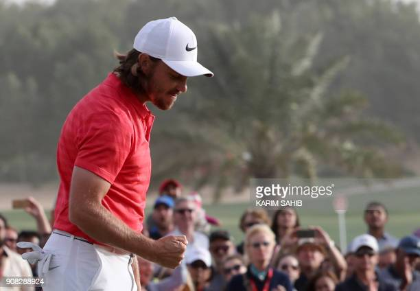 Tommy Fleetwood of England gestures as he walks on the green while celebrating his victory at the Abu Dhabi HSBC Golf Championship at the Abu Dhabi...