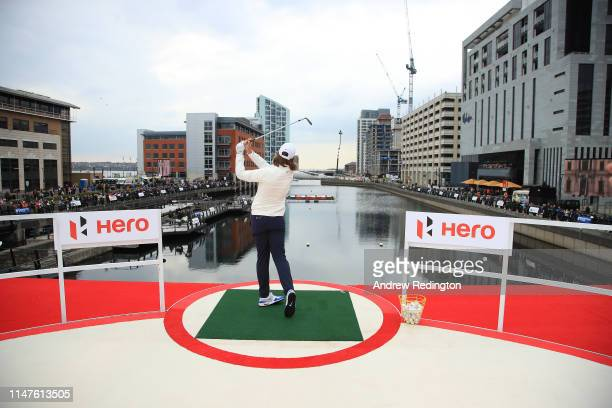 Tommy Fleetwood of England hits a shot during the Hero Challenge at Liverpool Waters' Princes Dock on May 07, 2019 in Liverpool, United Kingdom.