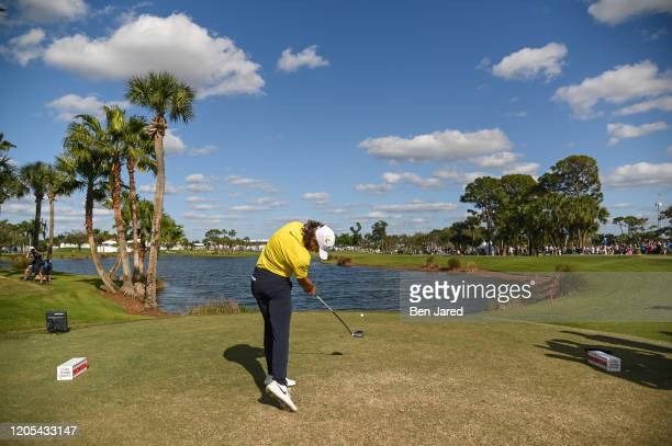 Tommy Fleetwood of England hits a shot on the ninth tee during the final round of The Honda Classic at PGA National Champion course on March 1 2020...