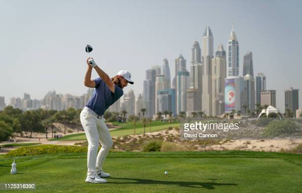 Tommy Fleetwood of England hits his a tee shot on the eighth hole during the final round of the Omega Dubai Desert Classic on the Majlis Course at...