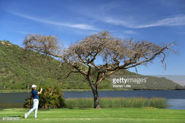 Tommy Fleetwood of England hits his second shot on the 17th hole during the first round of the Nedbank Golf Challenge at Gary Player CC on November 9...