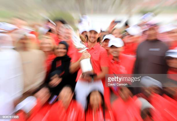Tommy Fleetwood of England holds the Falcon Trophy after his win in the final round of the Abu Dhabi HSBC Golf Championship at Abu Dhabi Golf Club on...