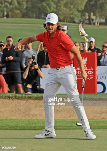 Tommy Fleetwood of England holes his final putt for birdie on the 18th green for his two shot win during the final round of the Abu Dhabi HSBC Golf...