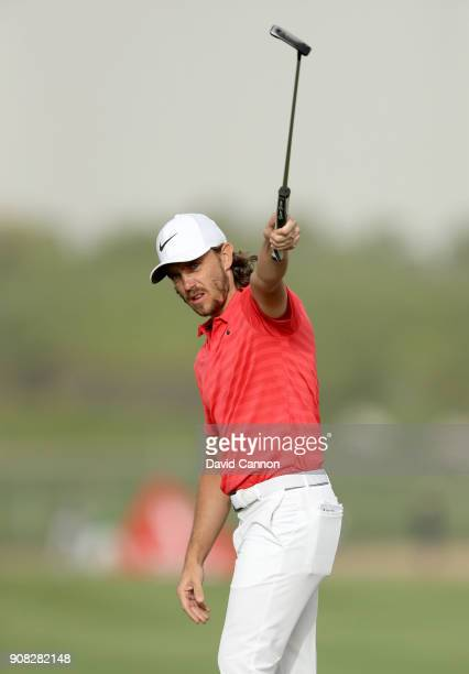 Tommy Fleetwood of England holes his for birdie on the 16th green on the way to his two shot win during the final round of the Abu Dhabi HSBC Golf...