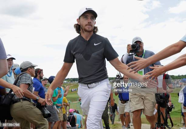 Tommy Fleetwood of England interacts with fans while walking to the sixth green during the final round of the 2017 US Open at Erin Hills on June 18...