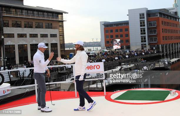 Tommy Fleetwood of England is congratulated by Matt Wallace of England after winning the Hero Challenge at Liverpool Waters' Princes Dock on May 07...