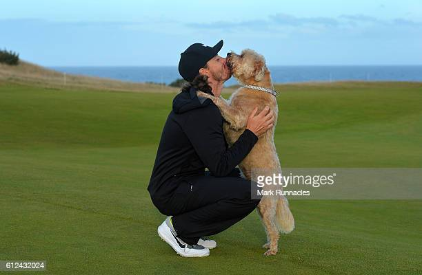 Tommy Fleetwood of England is greeted by his prized pooch 'Cooky' as he plays in a practice round during the Alfred Dunhill Links Championship...