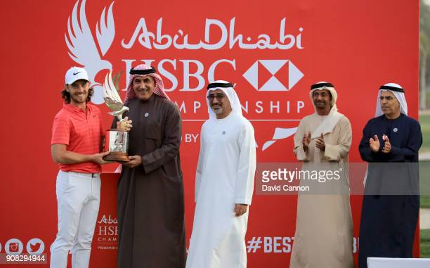 Tommy Fleetwood of England is presented with the Falcon Trophy by Major General Khalfan Al Romaithi The Chairman of the UAE General Authority of...