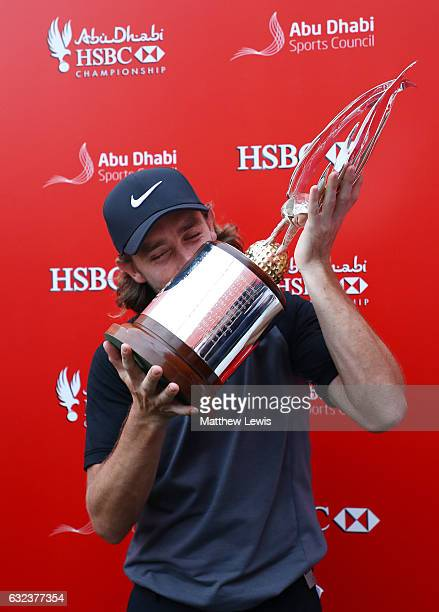 Tommy Fleetwood of England kisses the tropy after winning the tournament during the final round of the Abu Dhabi HSBC Championship at Abu Dhabi Golf...
