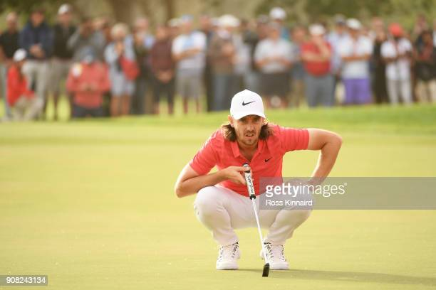 Tommy Fleetwood of England lines up a putt on the 17th green during the final round of the Abu Dhabi HSBC Golf Championship at Abu Dhabi Golf Club on...