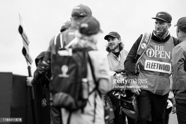 Tommy Fleetwood of England meets his walking scorers as he walks to the first tee during the final round of the 148th Open Championship held on the...