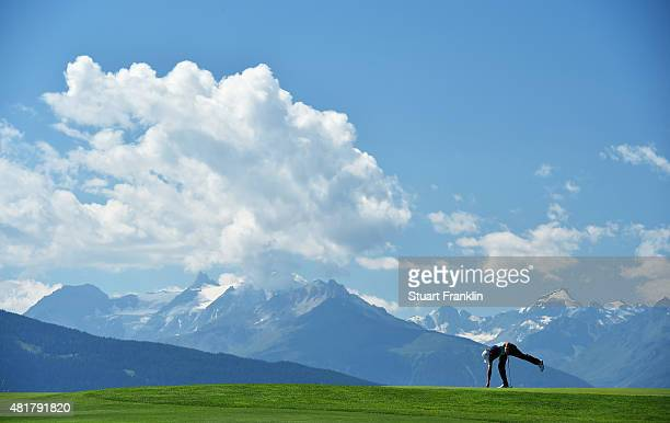 Tommy Fleetwood of England picks up his golf ball during the second round of the Omega European Masters at Crans-sur-Sierre Golf Club on July 24,...