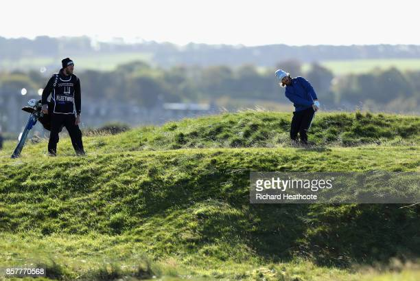 Tommy Fleetwood of England pitches onto Tyrell Hatton of England 5th green during day one of the 2017 Alfred Dunhill Championship at The Old Course...