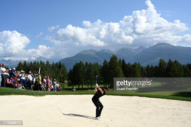 Tommy Fleetwood of England plays a bunker shot on the twelfth during Day One of the Omega European Masters at Crans Montana Golf Club on August 29...