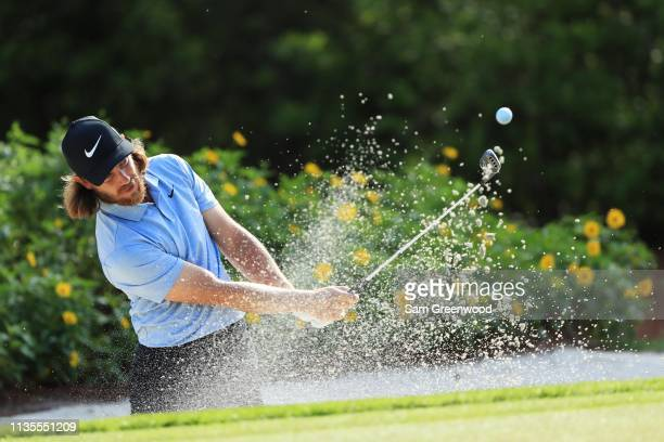 Tommy Fleetwood of England plays a shot from a bunker during a practice round for The PLAYERS Championship on The Stadium Course at TPC Sawgrass on...