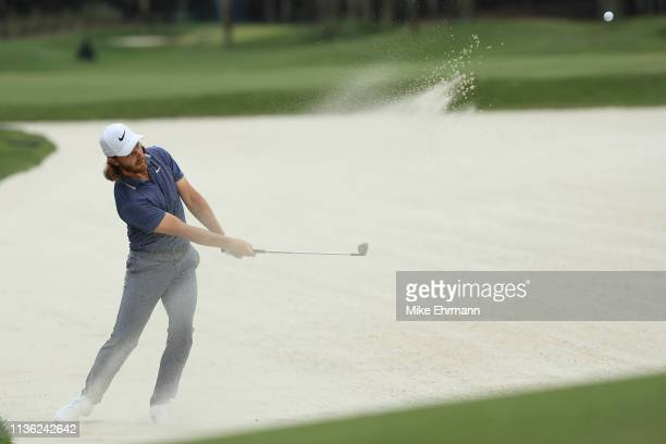 Tommy Fleetwood of England plays a shot from a bunker during the third round of The PLAYERS Championship on The Stadium Course at TPC Sawgrass on...
