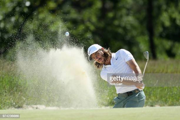 Tommy Fleetwood of England plays a shot from a bunker on the second hole during the first round of the 2018 US Open at Shinnecock Hills Golf Club on...