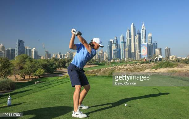Tommy Fleetwood of England plays a shot from the eighth tee during the proam as a preview for the Omega Dubai Desert Classic on the Majlis Course at...