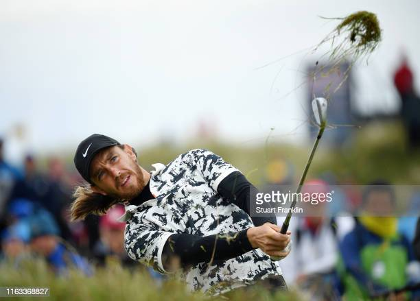 Tommy Fleetwood of England plays a shot on the 17th hole during the final round of the 148th Open Championship held on the Dunluce Links at Royal...