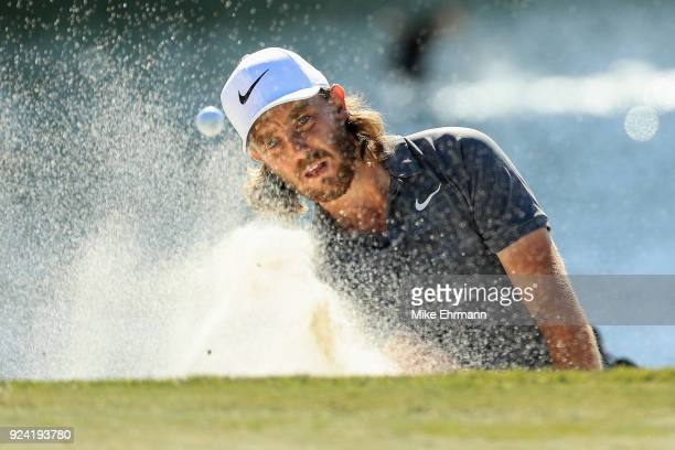 Tommy Fleetwood of England plays a shot on the sixth hole during the final round of the Honda Classic at PGA National Resort and Spa on February 25...