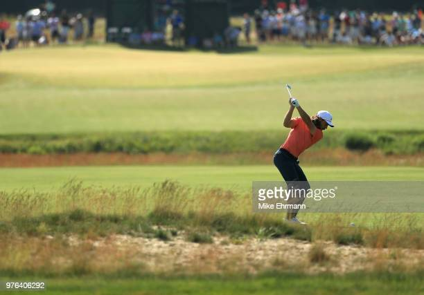 Tommy Fleetwood of England plays an approach shot on the sixth hole during the third round of the 2018 US Open at Shinnecock Hills Golf Club on June...