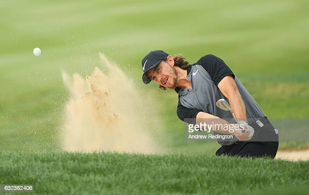 Tommy Fleetwood of England plays from a bunker on the 3rd hole during the final round of the Abu Dhabi HSBC Championship at Abu Dhabi Golf Club on...