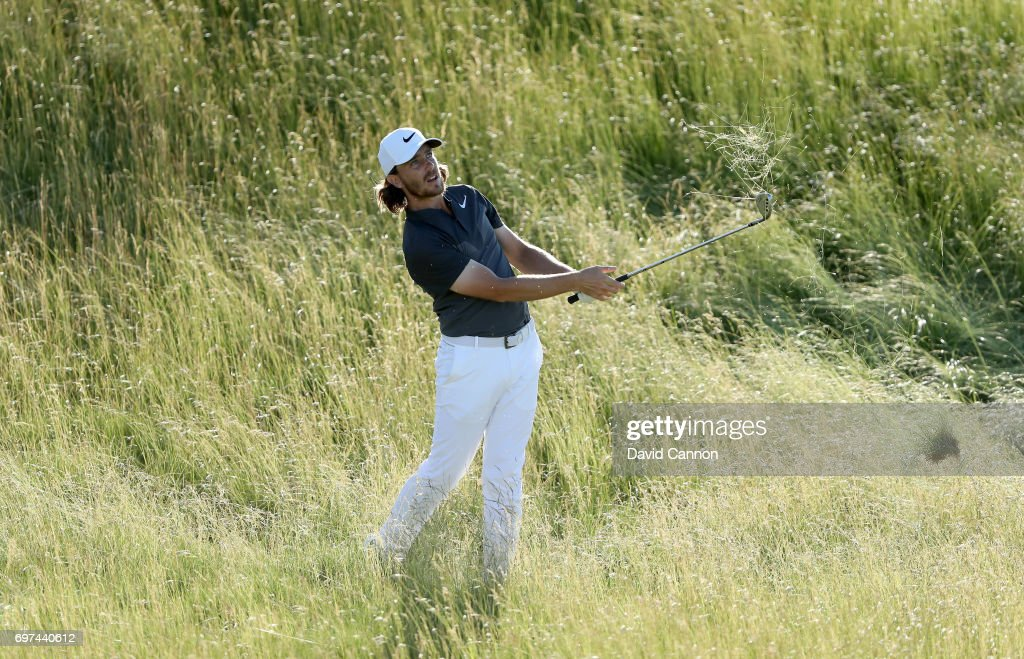 Tommy Fleetwood of England plays his second shot at the par 5, 18th hole during the final round of the 117th US Open Championship at Erin Hills on June 18, 2017 in Hartford, Wisconsin.