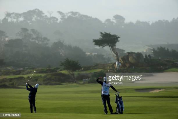 Tommy Fleetwood of England plays his second shot on the 12th hole during the first round of the ATT Pebble Beach ProAm at Monterey Peninsula Country...