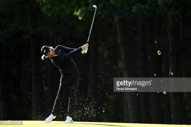 Tommy Fleetwood of England plays his second shot on the 13th hole during Day One of the BMW PGA Championship at Wentworth Golf Club on October 08,...