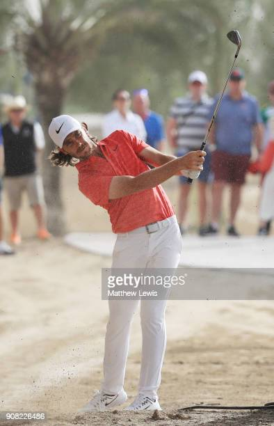 Tommy Fleetwood of England plays his second shot on the 13th hole during the final round of the Abu Dhabi HSBC Golf Championship at Abu Dhabi Golf...