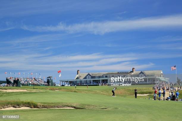 Tommy Fleetwood of England plays his second shot on the 18th hole on his way to scoring a seven under par 63 and ultimate second place by one shot to...