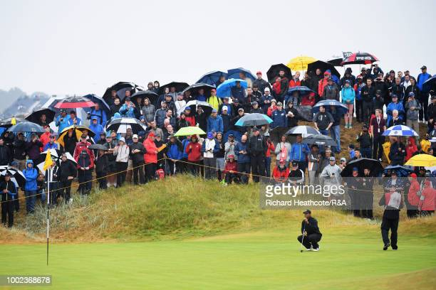 Tommy Fleetwood of England plays his second shot on the 18th hole during the second round of the 147th Open Championship at Carnoustie Golf Club on...
