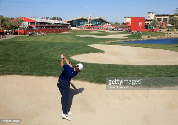 Tommy Fleetwood of England plays his second shot on the 18th hole during the final round of the Abu Dhabi HSBC Championship at Abu Dhabi Golf Club on...