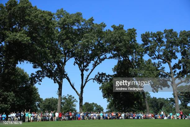 Tommy Fleetwood of England plays his second shot on the eighth hole during the first round of The Northern Trust on August 23 2018 at the Ridgewood...