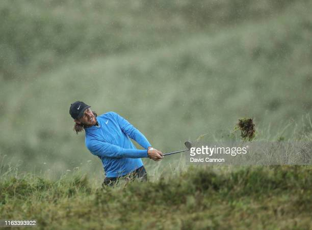 Tommy Fleetwood of England plays his second shot on the eighth hole during the final round of the 148th Open Championship held on the Dunluce Links...