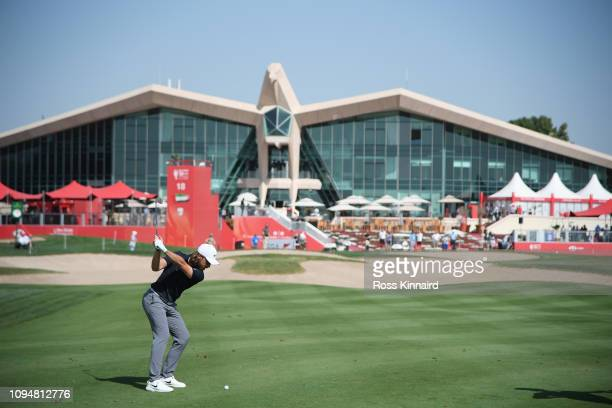 Tommy Fleetwood of England plays his second shot on the ninth hole during Day One of the Abu Dhabi HSBC Golf Championship at Abu Dhabi Golf Club on...