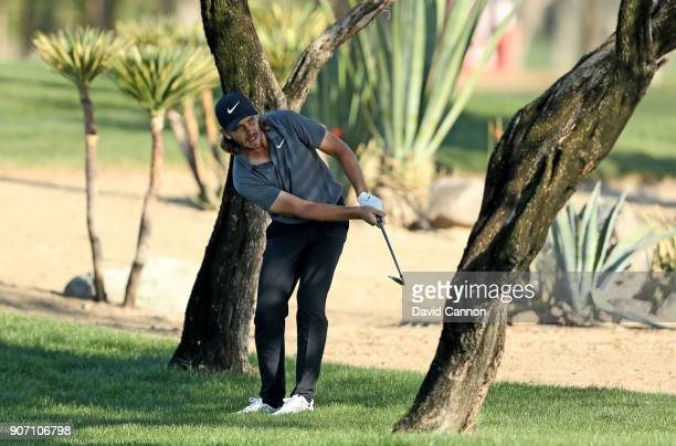 Tommy Fleetwood of England plays his second shot on the par 4, 16th hole during the second round of the 2018 Abu Dhabi HSBC Golf Championship at the...