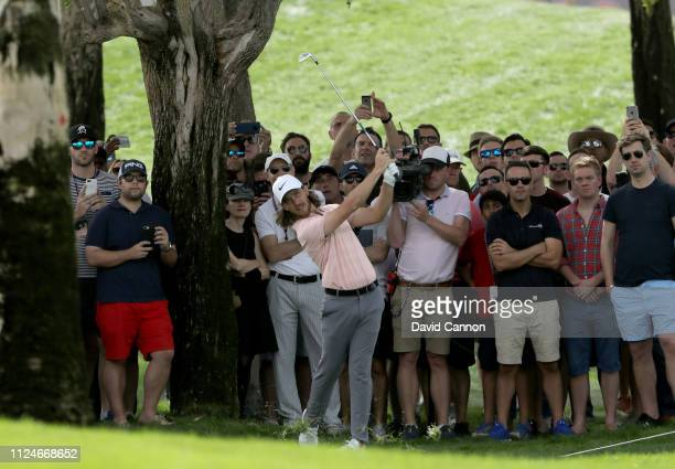 Tommy Fleetwood of England plays his second shot on the par 4 first hole during the second round of the Omega Dubai Desert Classic on the Majlis...