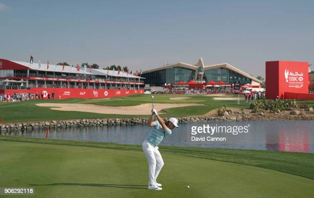 Tommy Fleetwood of England plays his second shot on the par 5 18th hole during the first round of the 2018 Abu Dhabi HSBC Golf Championship at the...