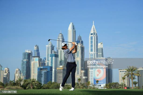 Tommy Fleetwood of England plays his second shot on the thirteenth hole during Day One of the Omega Dubai Desert Classic at Emirates Golf Club on...
