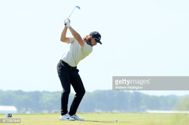 Tommy Fleetwood of England plays his shot from the 15th tee during the final round of the 2018 US Open at Shinnecock Hills Golf Club on June 17 2018...