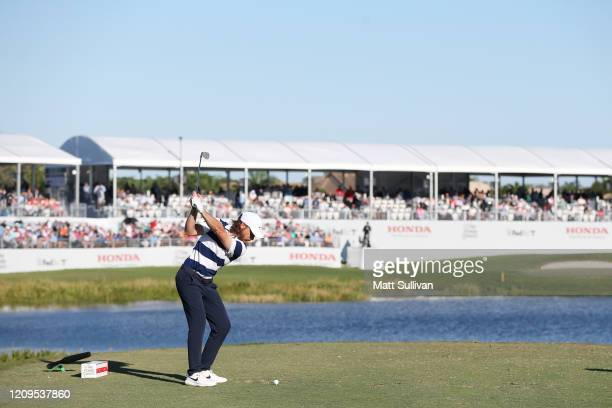 Tommy Fleetwood of England plays his shot from the 17th tee during the third round of the Honda Classic at PGA National Resort and Spa Champion...