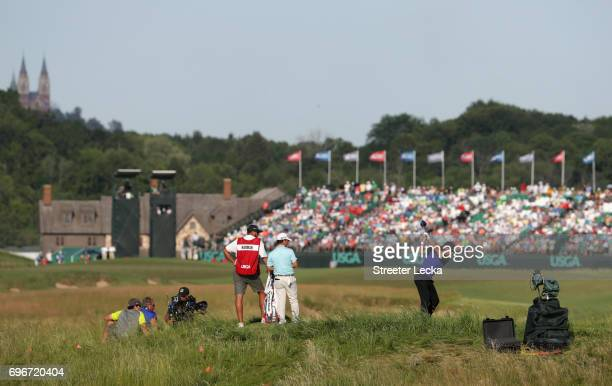 Tommy Fleetwood of England plays his shot from the 18th tee during the second round of the 2017 US Open at Erin Hills on June 16 2017 in Hartford...