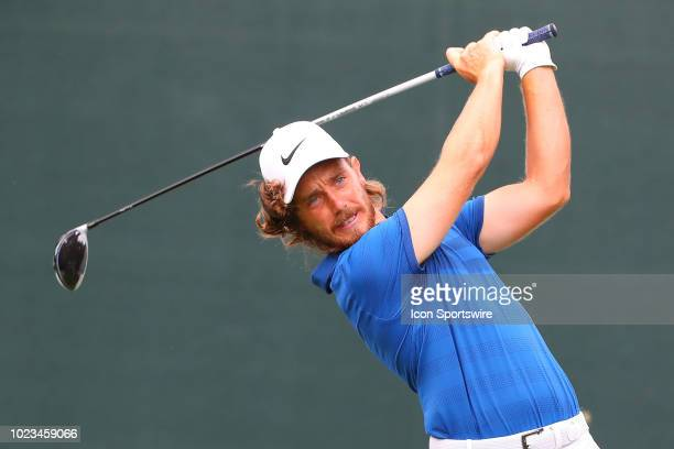 Tommy Fleetwood of England plays his shot from the first tee during the third round of The Northern Trust on August 25, 2018 at the Ridgewood...
