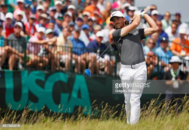 Tommy Fleetwood of England plays his shot from the first tee during the final round of the 2017 US Open at Erin Hills on June 18 2017 in Hartford...